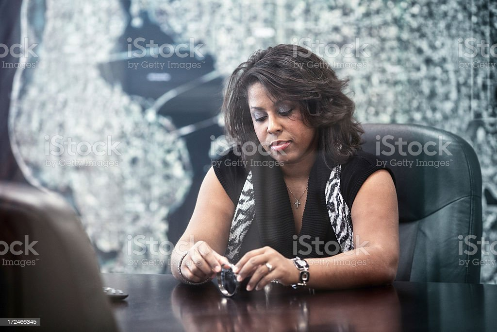 Pensive Office Worker Awaits Her Fate in Conference Room royalty-free stock photo