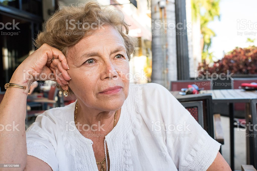 Pensive old woman stock photo