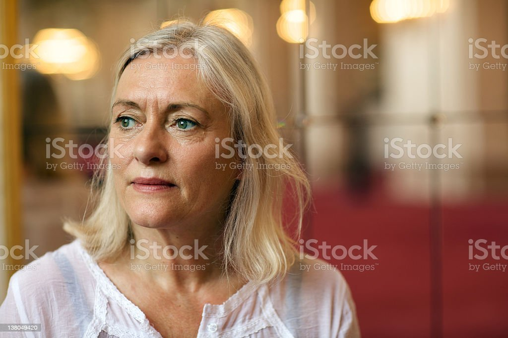 pensive senior lady with gray hair looks away royalty-free stock photo