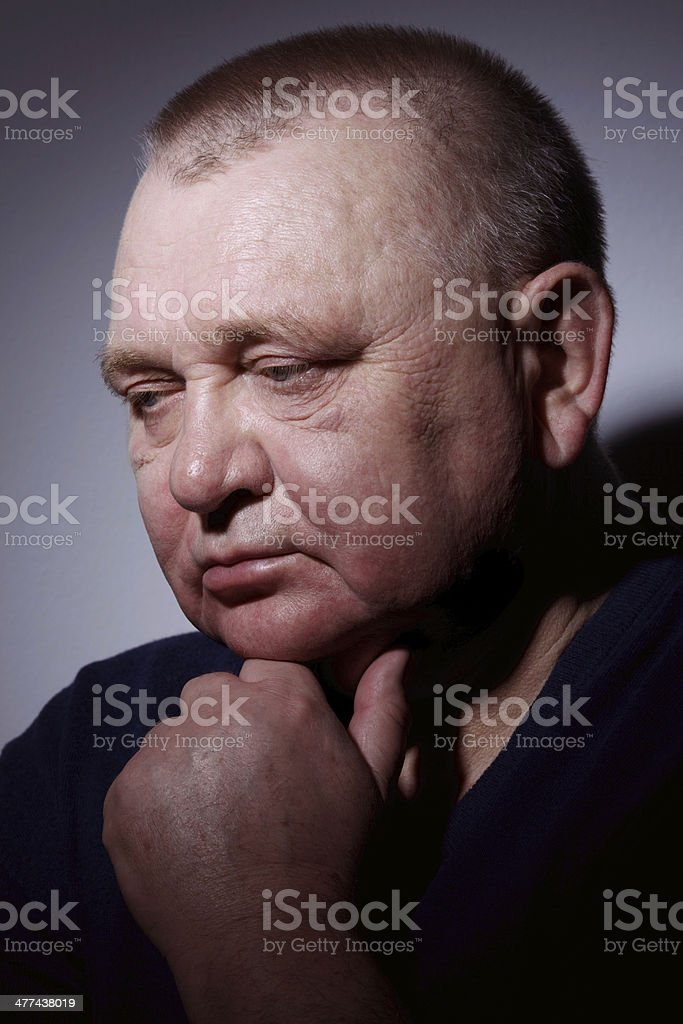 Pensive senior man closeup stock photo