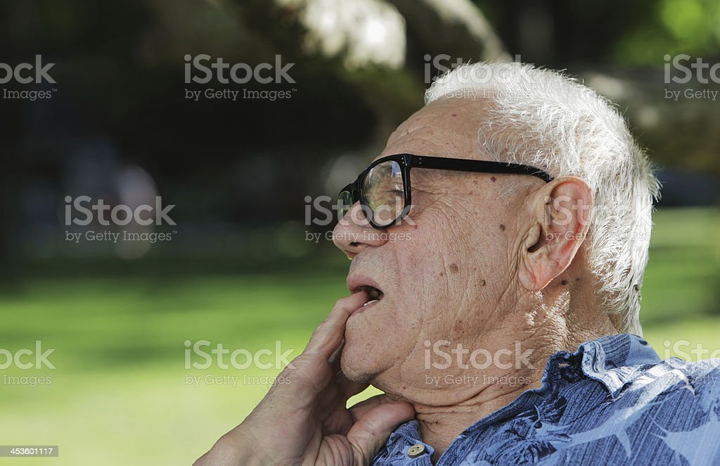 Pensive Senior Man Listening To Conversation stock photo