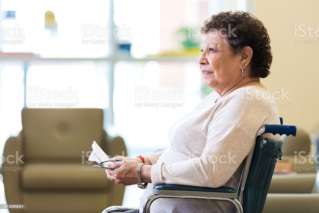 Pensive senior woman in nursing home stock photo