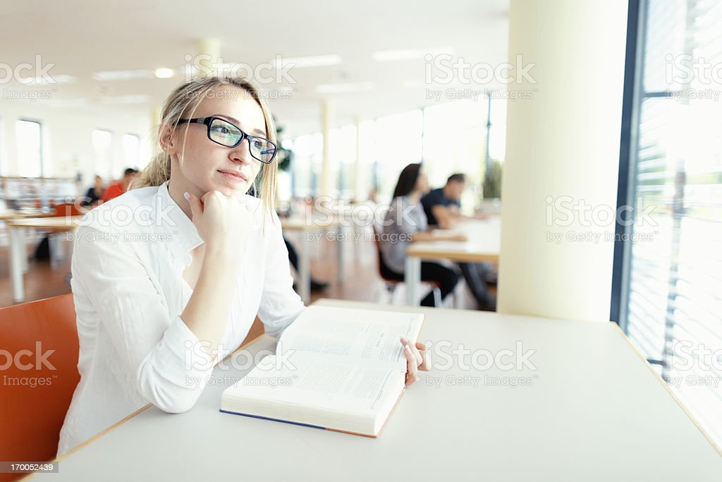 pensive student in library royalty-free stock photo