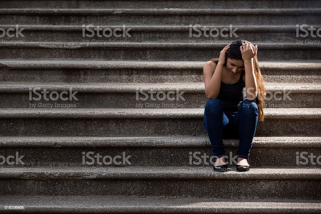 Pensive teenage girl stock photo