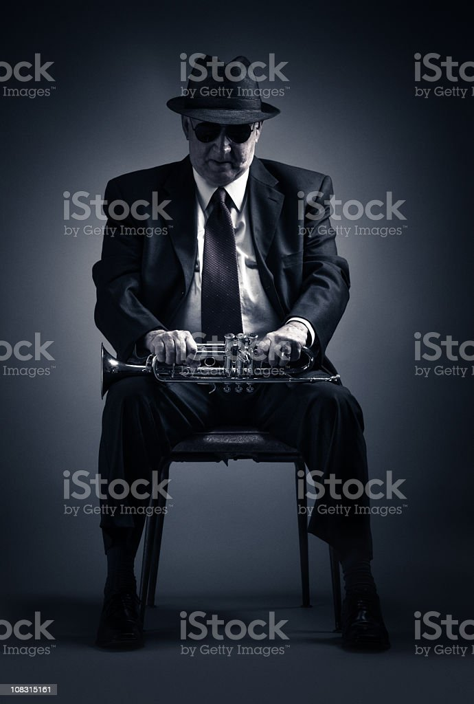 pensive trumpet player stock photo