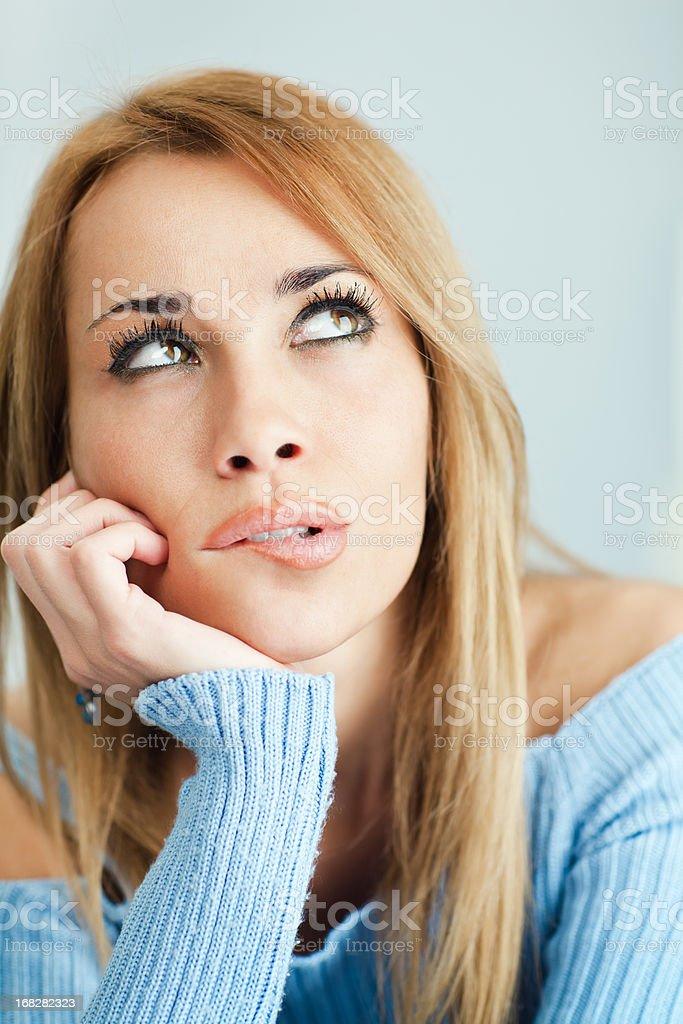 pensive woman biting lips royalty-free stock photo