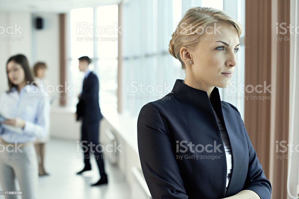 Pensive woman in office royalty-free stock photo