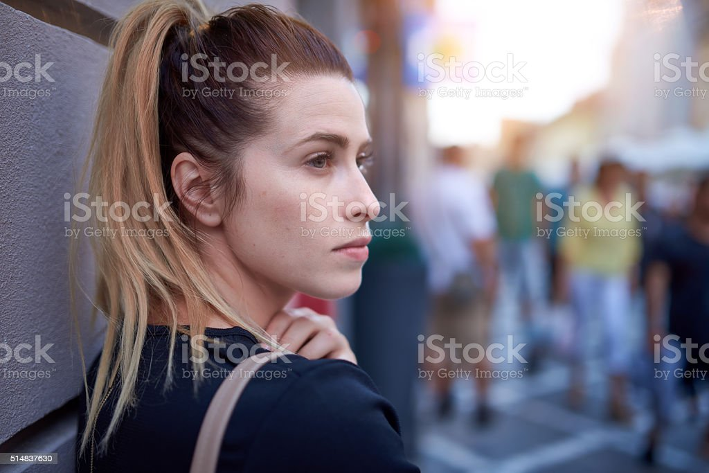 pensive woman in the city stock photo