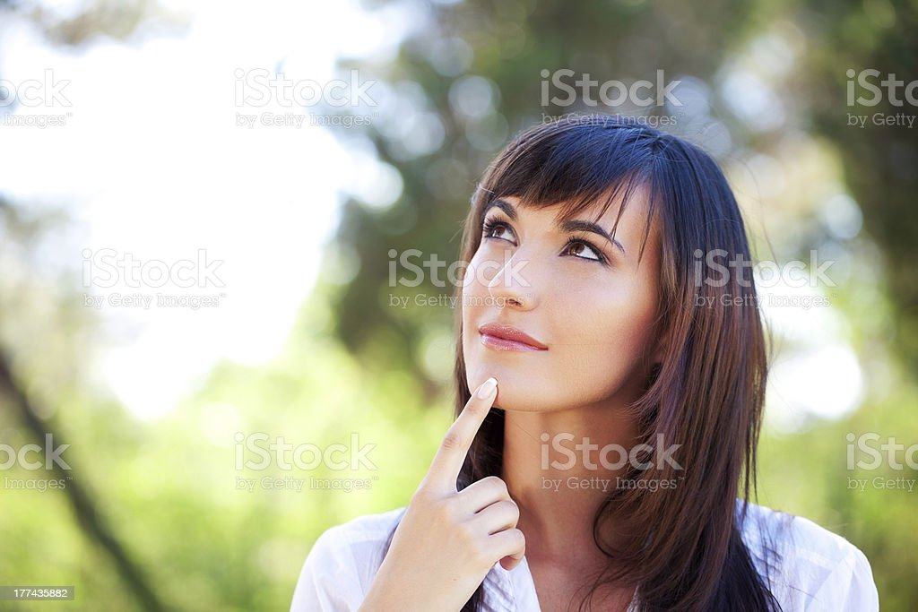Pensive Woman In The Nature stock photo