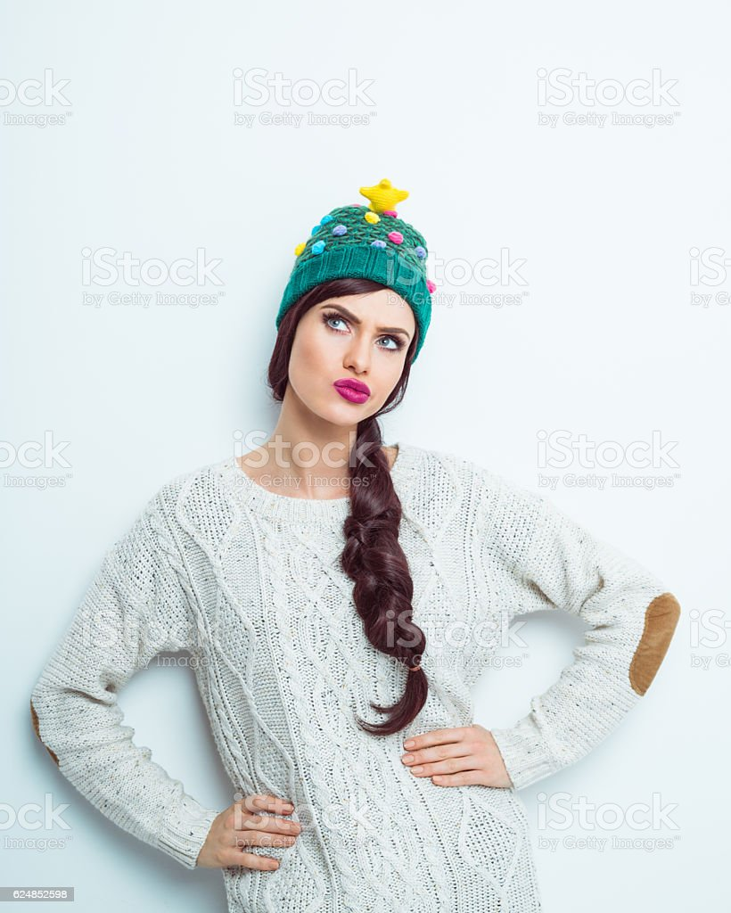 Pensive woman in winter outfit stock photo
