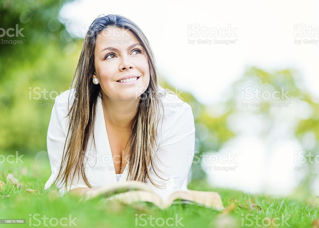 Pensive woman reading a book royalty-free stock photo