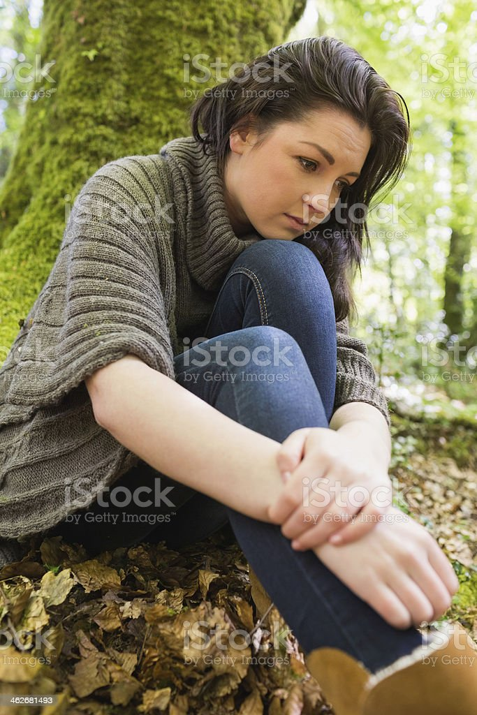 Pensive woman reflecting in green forest royalty-free stock photo