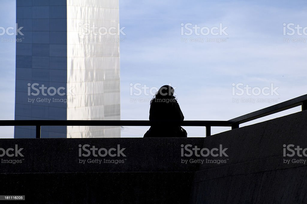 Pensive Woman Silhouetted Against St. Louis Arch royalty-free stock photo
