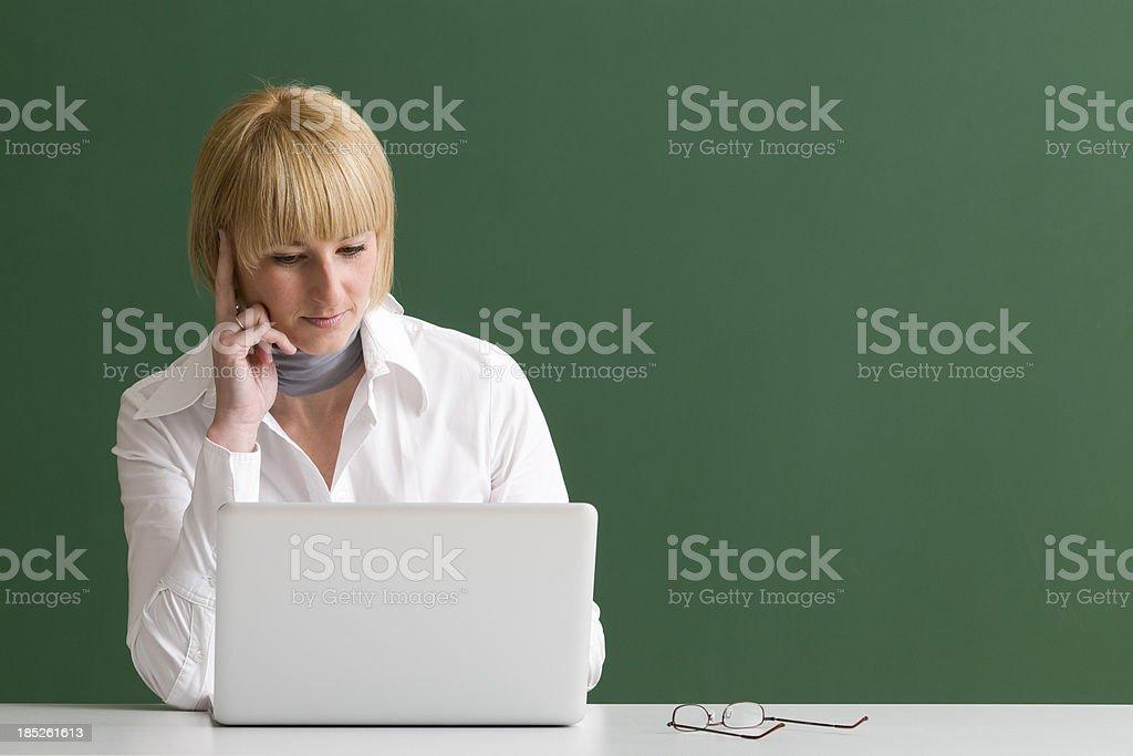 pensive woman working at laptop royalty-free stock photo