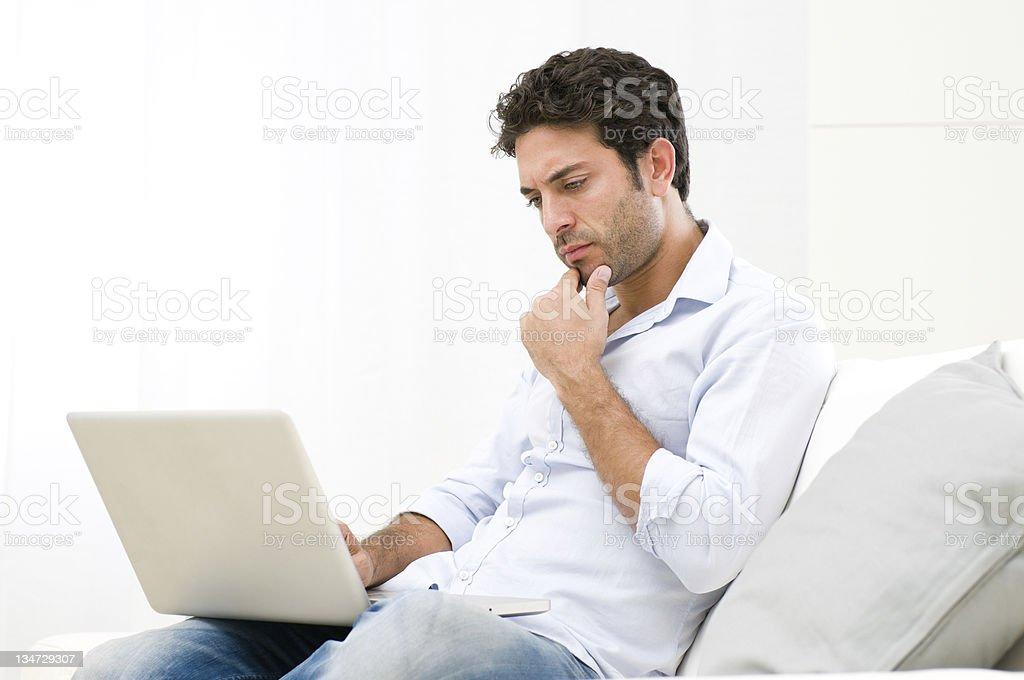 Pensive worried guy at laptop royalty-free stock photo