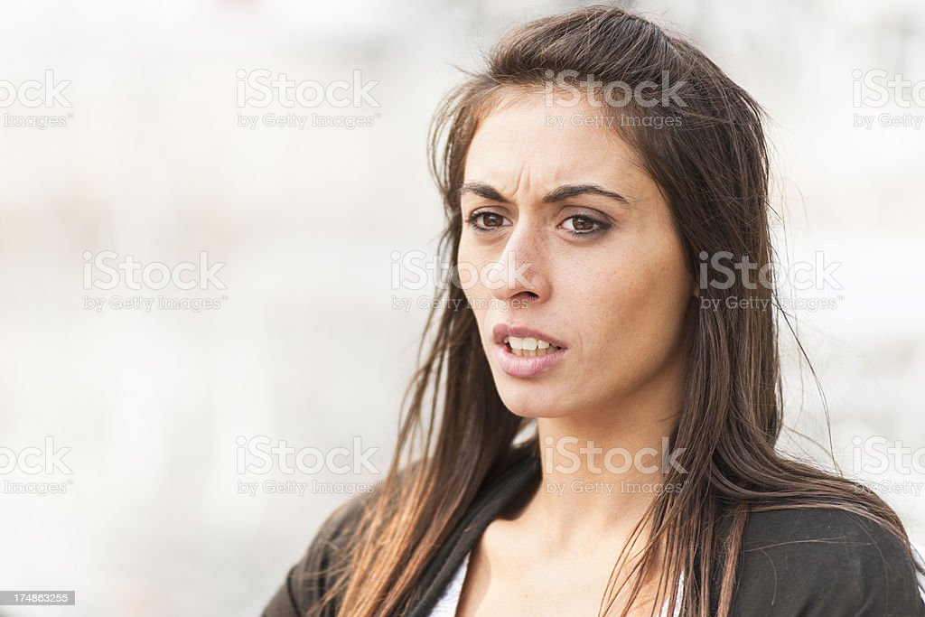Pensive young adult woman outdoors royalty-free stock photo