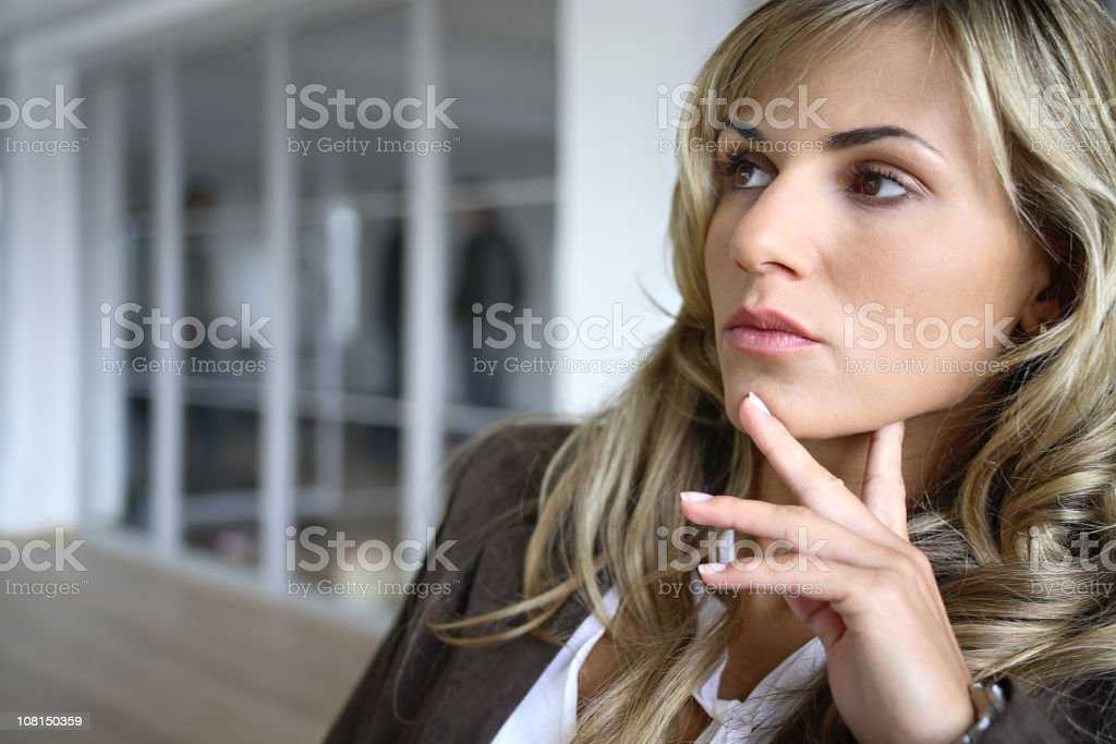 Pensive Young Businesswoman Sitting royalty-free stock photo