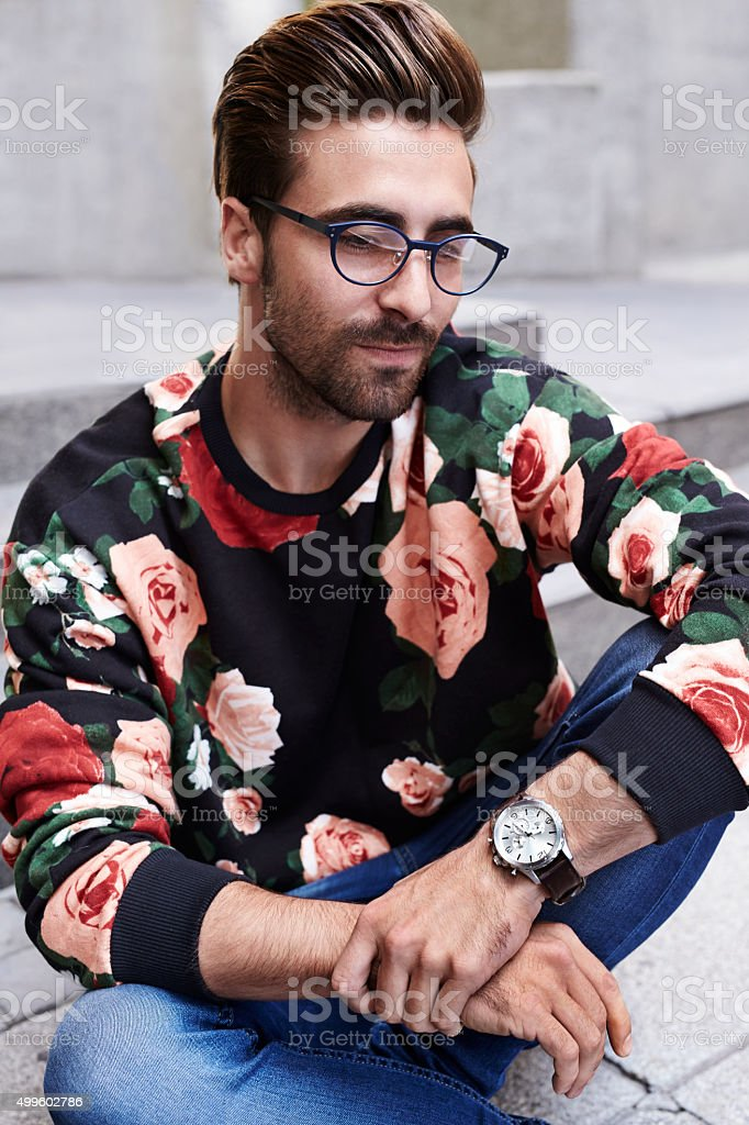 Pensive young hipster stock photo