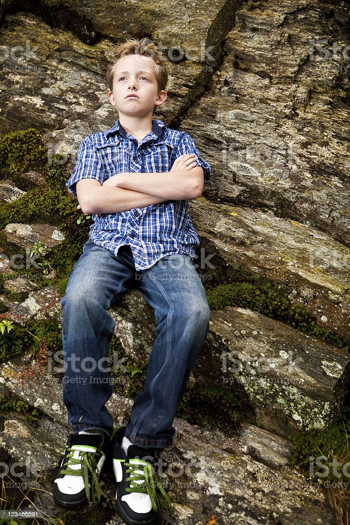 Pensive young man on school field trip stock photo