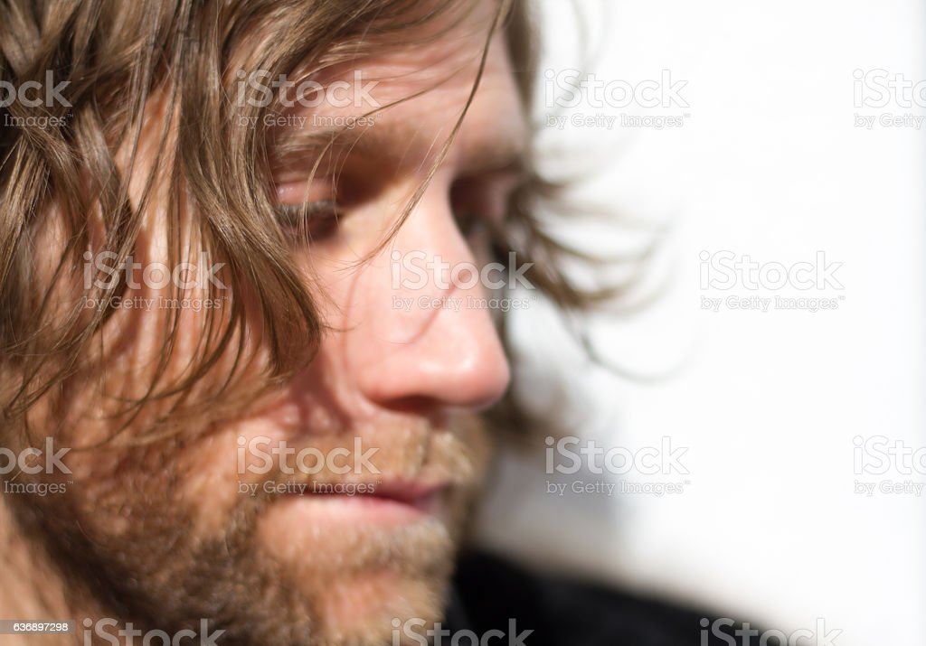 Pensive Young Man with Beard, Profile (Close-Up Portrait) stock photo