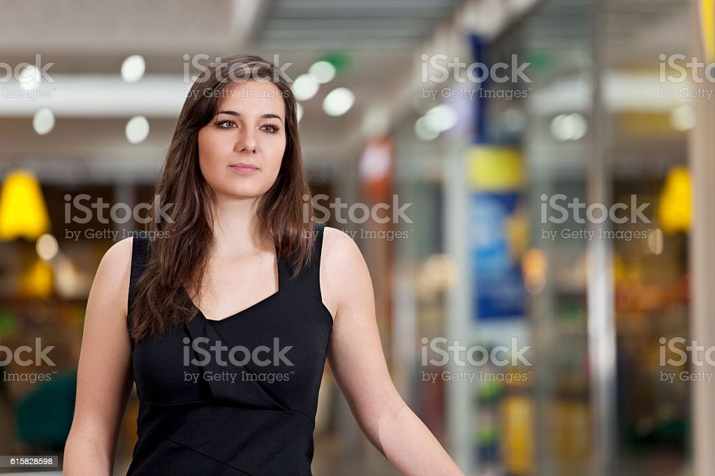 Pensive young woman is waiting for somebody stock photo