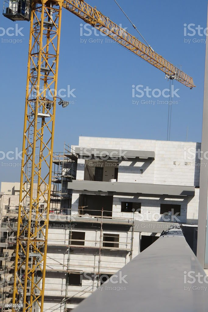 Penthouse and  construction crane stock photo