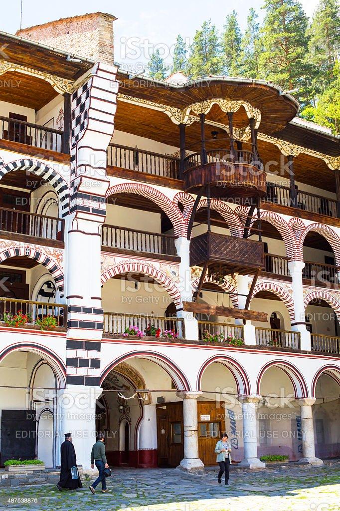 Peole at the territory of famous Rila Monastery, Bulgaria stock photo