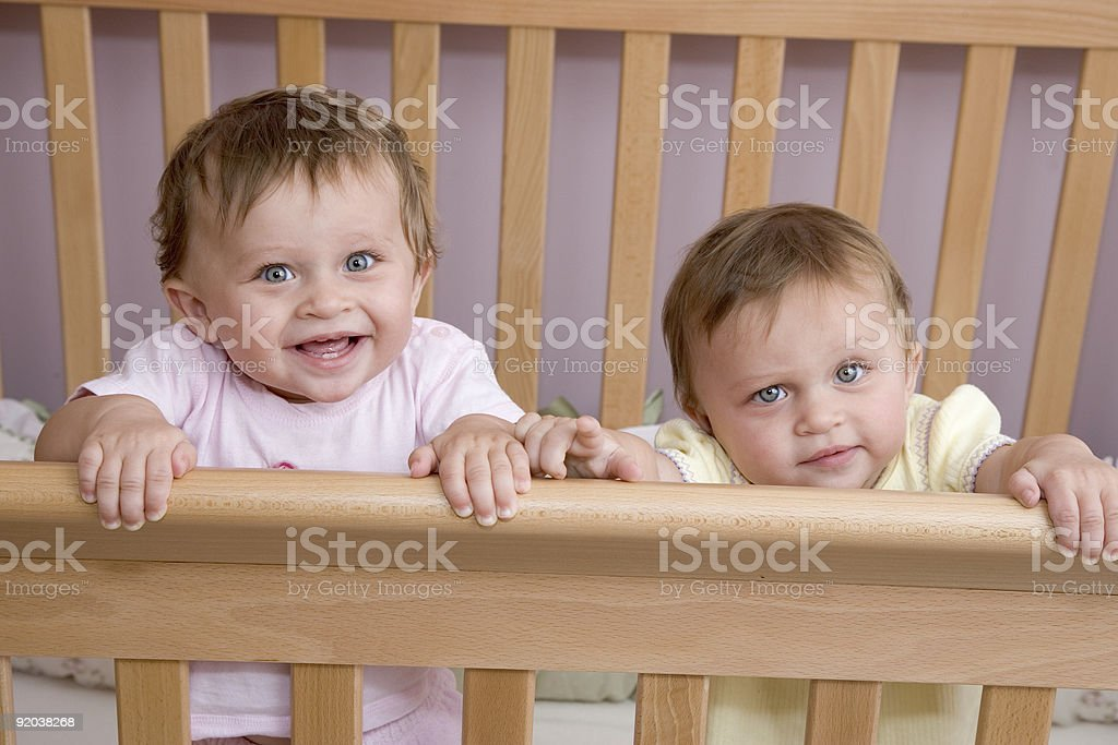 People - 10 Month Old Twin Baby Girls in Crib royalty-free stock photo