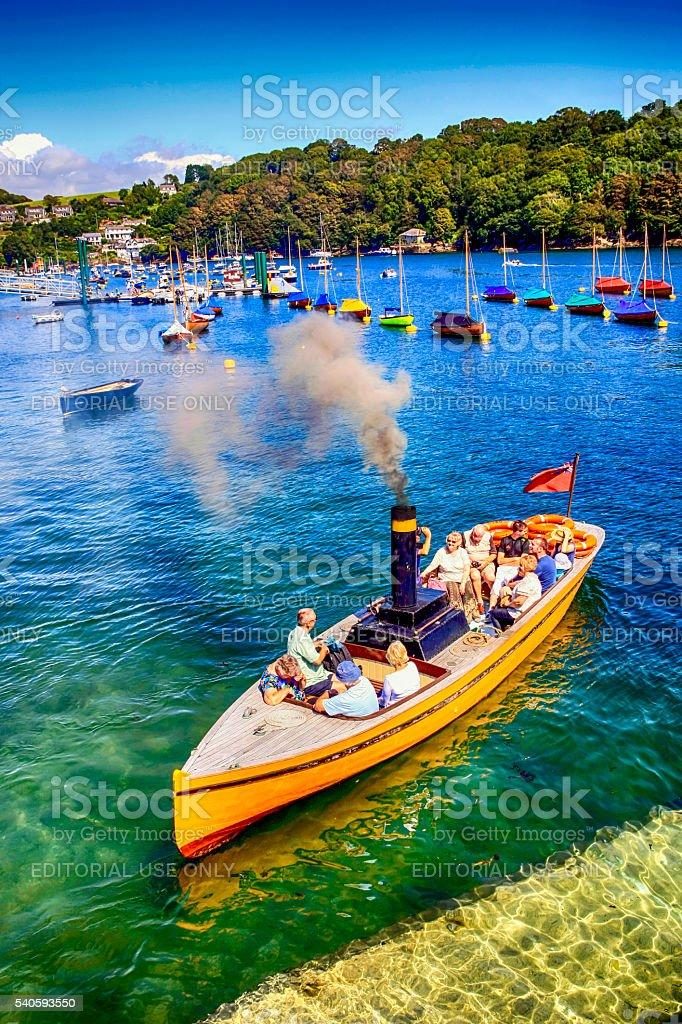 People aboard a Cornish steamboat leaving Fowey, UK stock photo