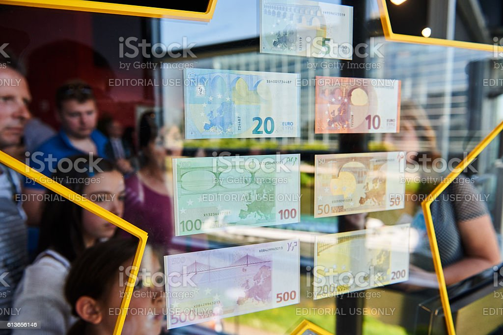 People admiring all European Union Euro notes stock photo