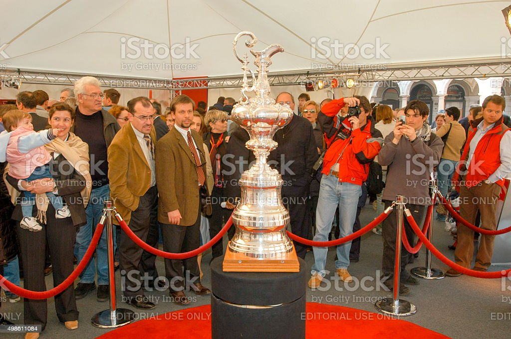 People admiring and photographing the America's Cup stock photo