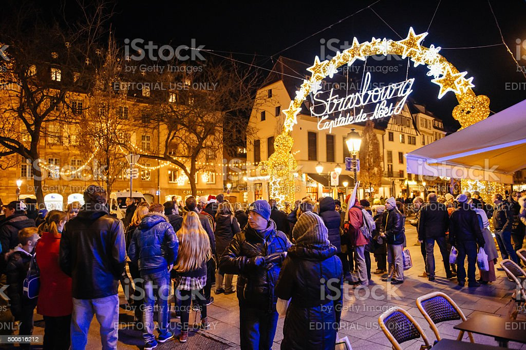 People admiring neon sign Christmas Market, Captial de noel, stock photo