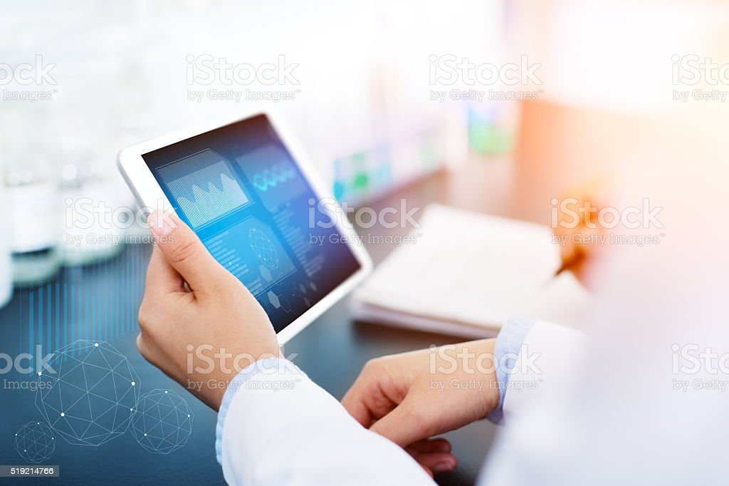 people analysis chemical experiment by tablet in modern lab stock photo
