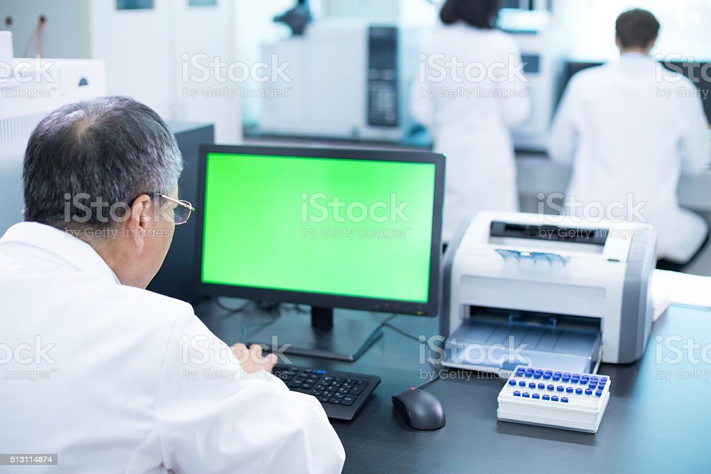 people analysis experimental data in computer stock photo