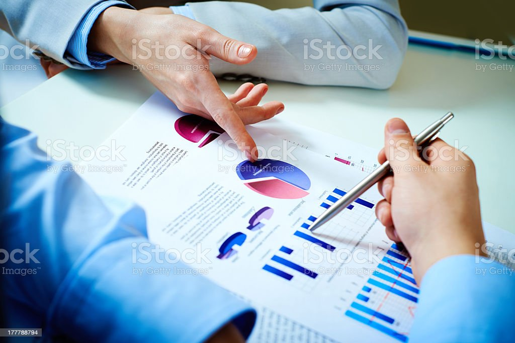 People analyzing a financial report royalty-free stock photo