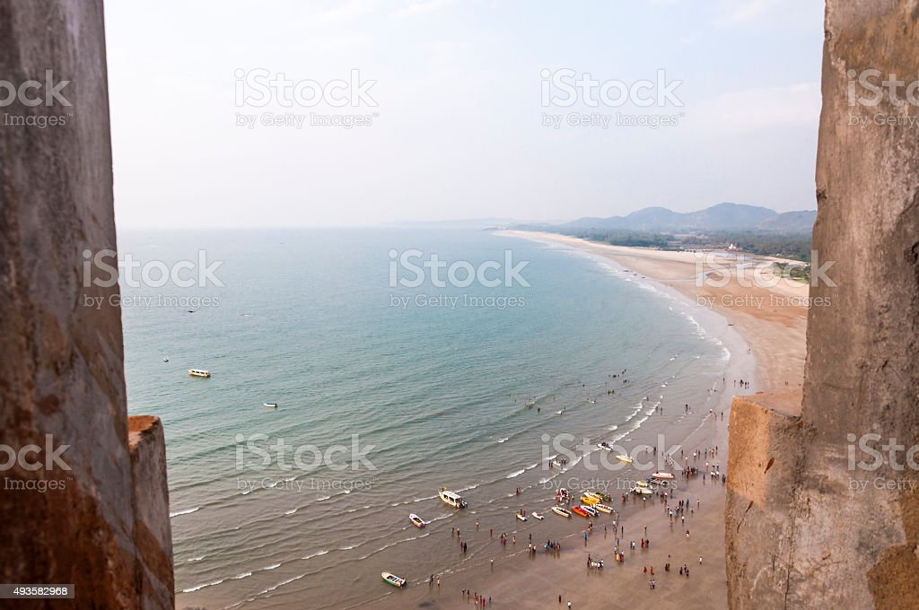 People and boats on Arabian sea coastline in Murudeshwar India stock photo