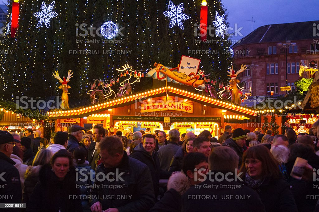 People and booth for sausages on xmas market stock photo