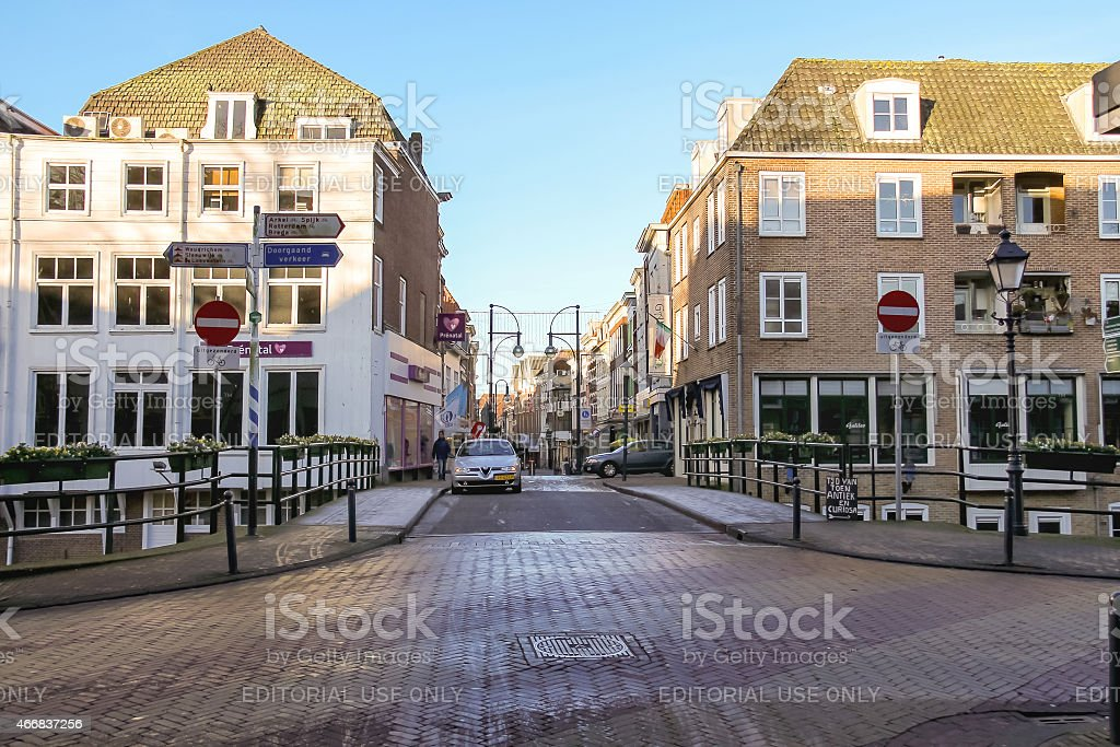 People and cars in the Dutch town Gorinchem. stock photo