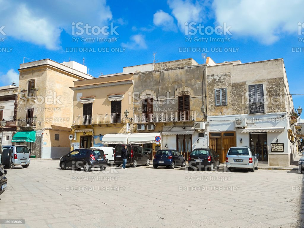 People and cars on the Piazza Europa in Favignana stock photo