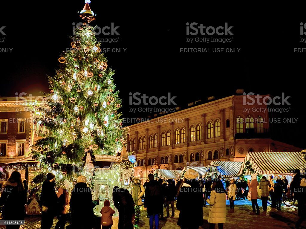 People and Christmas tree at market in Riga Dome square stock photo