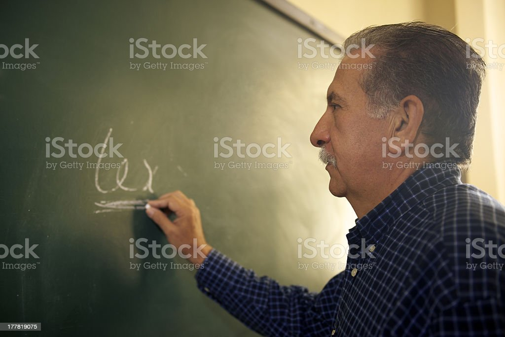 People and education, law teacher writing on blackboard in colle royalty-free stock photo