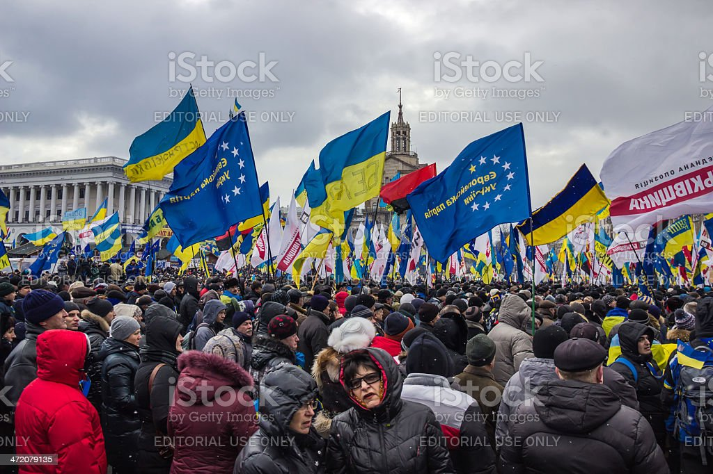People and flags at meeting in Kiev stock photo
