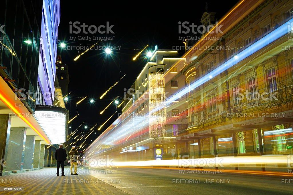 People and flying stars on main street in Ljubljana stock photo