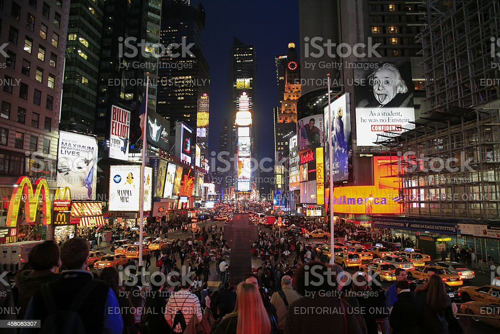 People and lights at night, Time Square, New York City stock photo
