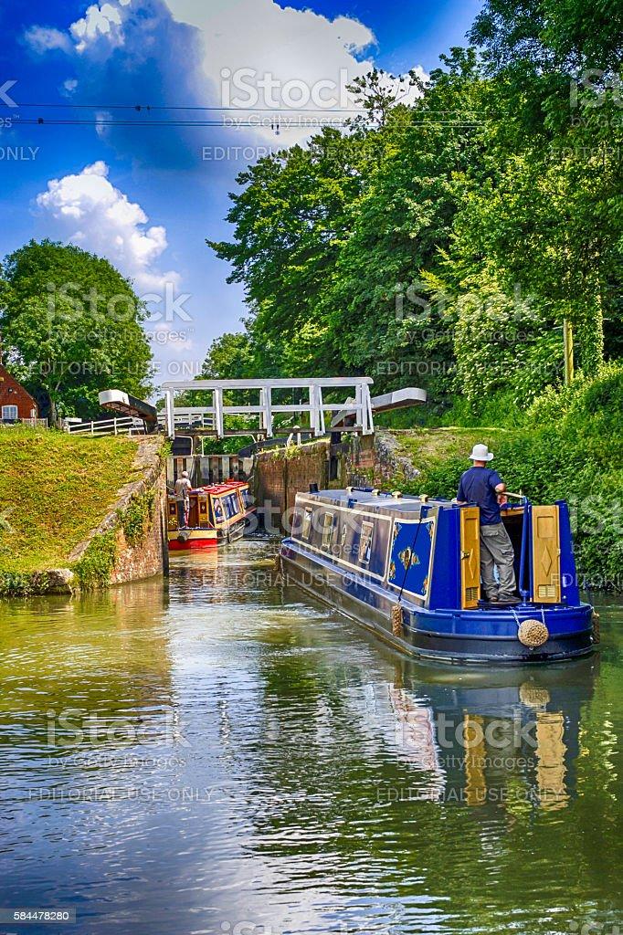 People and Narrowboats at the canal locks at Devizes, UK stock photo