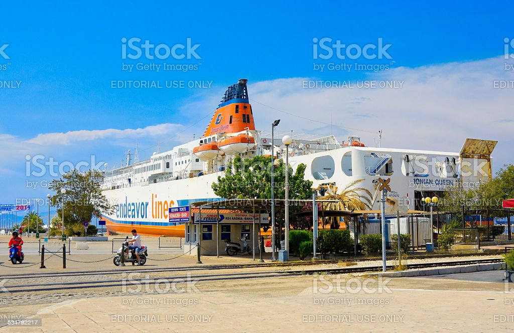 People and ocean liner in port of Patras, Greece stock photo