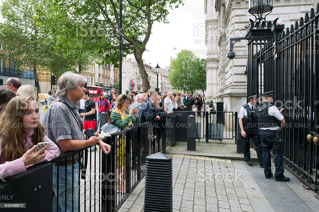 People and police officers outside Downing Street stock photo