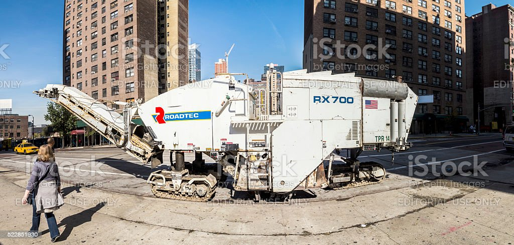 people and Roadtec street machine in New York stock photo