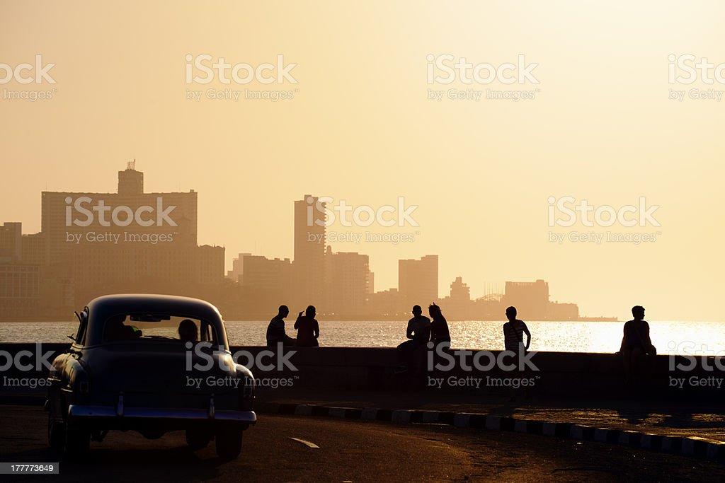 People and skyline of La Habana, Cuba, at sunset stock photo