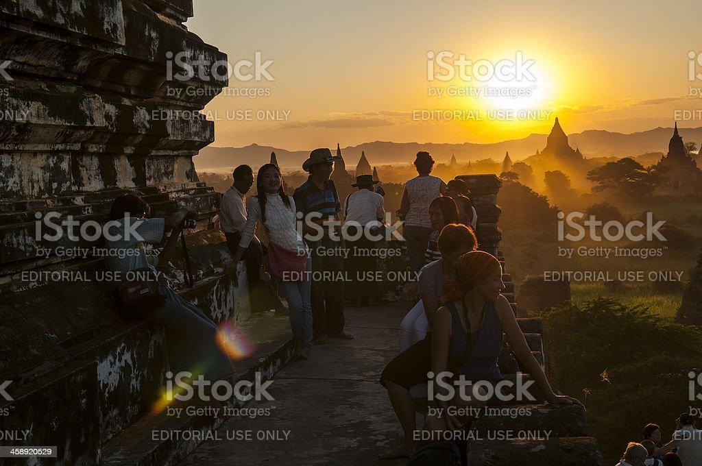 People and sunset at Shwesandaw Paya in Bagan stock photo
